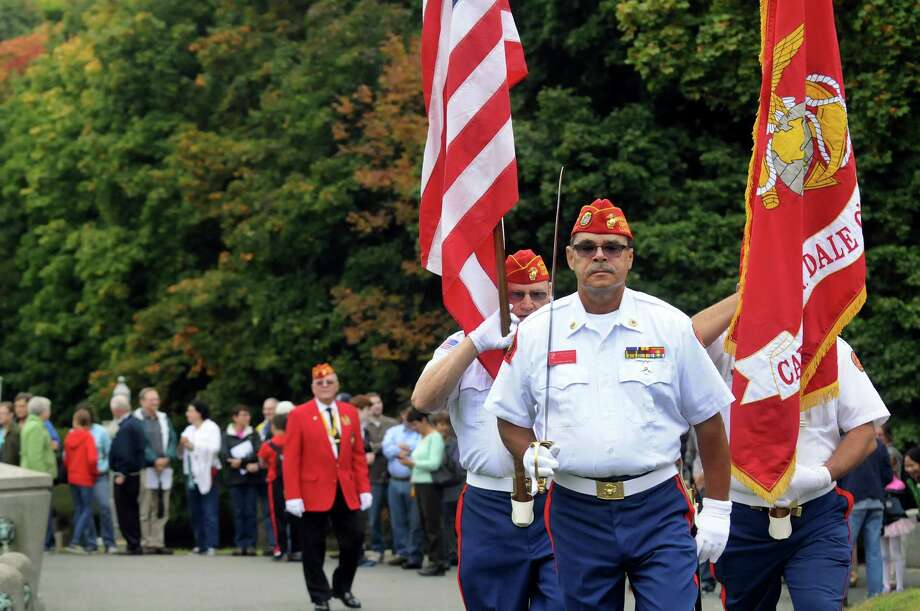Members of the Captain William Dale O'Brien Detachment of the Marine Corps League performs color guard duty during a scaled-down ceremony to President Chester Alan Arthur on his birthday on Saturday, Oct. 5, 2013, at Albany Rural Cemetery in Menands, N.Y. From left are Thomas DeMeo, in red jacket, Pete Grobecker, Capt. William Keyes, and Mick DellaValle. (Cindy Schultz / Times Union) Photo: Cindy Schultz / 00024128A