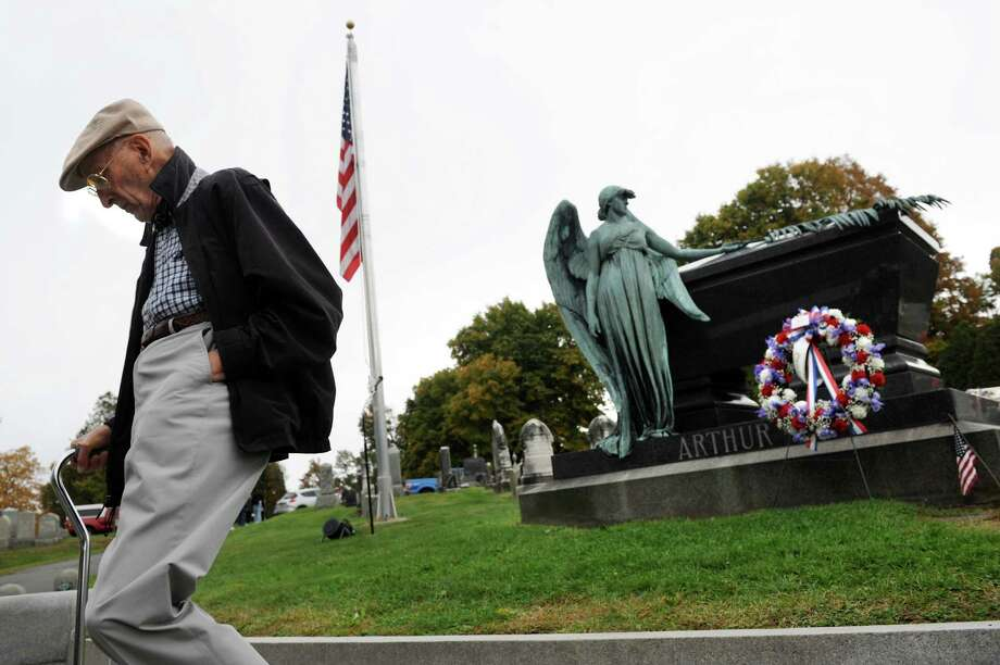 Norman Rice of Albany, a cemetery trustee, attends a scaled-down ceremony for President Chester Alan Arthur on his birthday on Saturday, Oct. 5, 2013, at Albany Rural Cemetery in Menands, N.Y. (Cindy Schultz / Times Union) Photo: Cindy Schultz / 00024128A