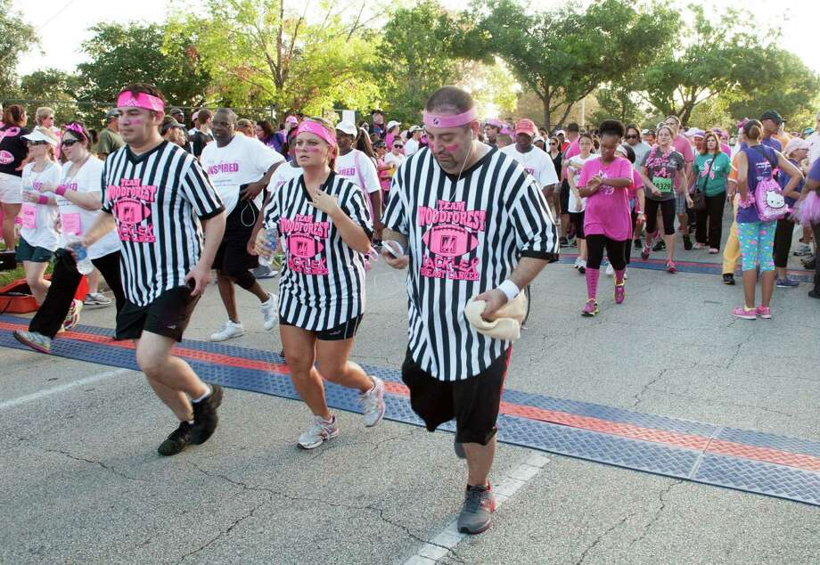 Team Woodforest in their referee gear at the start of the Susan G. Komen Race For the Cure. Photo: Jamaal Ellis, For The Chronicle / ©2013 Houston Chronicle