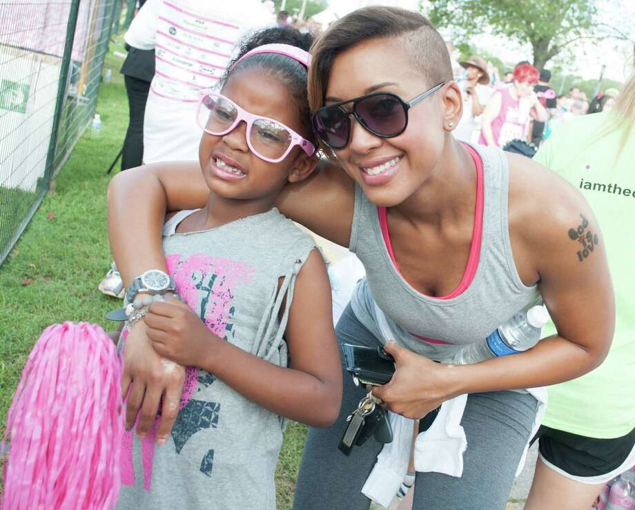 KBXX host JJ Simmons with her daughter at the Susan G. Komen Race For the Cure. Photo: Jamaal Ellis, For The Chronicle / ©2013 Houston Chronicle