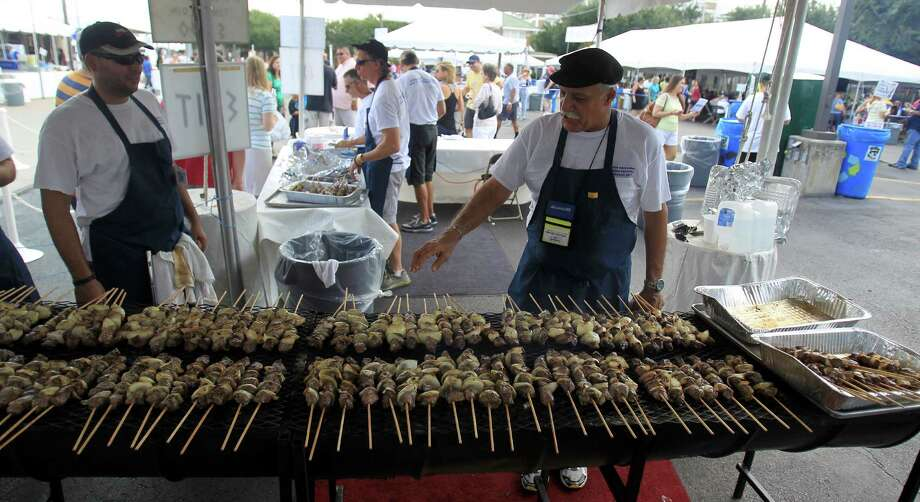 Lou Quintana works on the souvlakis, beef tenderloin on a stick, at the 47th annual Greek Festival at the Annunciation Greek Orthodox Cathedral, Saturday,Oct. 5, 2013, in Houston. The festival runs until Sunday, from noon to 6 p.m. Photo: Karen Warren, Houston Chronicle / © 2013 Houston Chronicle