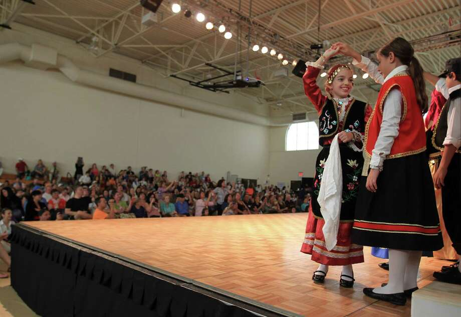 Young Greek dancers on stage during the children's dance program at the 47th annual Greek Festival at the Annunciation Greek Orthodox Cathedral, Saturday,Oct. 5, 2013, in Houston. The festival runs until Sunday, from noon to 6 p.m. Photo: Karen Warren, Houston Chronicle / © 2013 Houston Chronicle