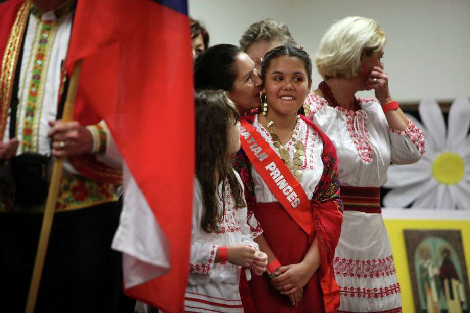 Susan Ceuric whispers to her granddaughter Jazell Ceuric before she is announced as the Croatian Princess during the 50th Annual Sts. Gyril & Methodius Slavic Heritage Festival held at Knights of Columbus Hall and Grounds on Sunday, Sept. 29, 2013, in Houston. Photo: Mayra Beltran, Houston Chronicle / © 2013 Houston Chronicle