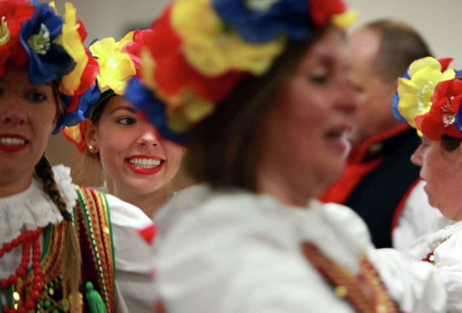 Alicia Dwornik, 19, smiles while performing with the Wawel Polish Folk Dance Group during the 50th Annual Sts. Gyril & Methodius Slavic Heritage Festival held at Knights of Columbus Hall and Grounds on Sunday, Sept. 29, 2013, in Houston. Photo: Mayra Beltran, Houston Chronicle / © 2013 Houston Chronicle