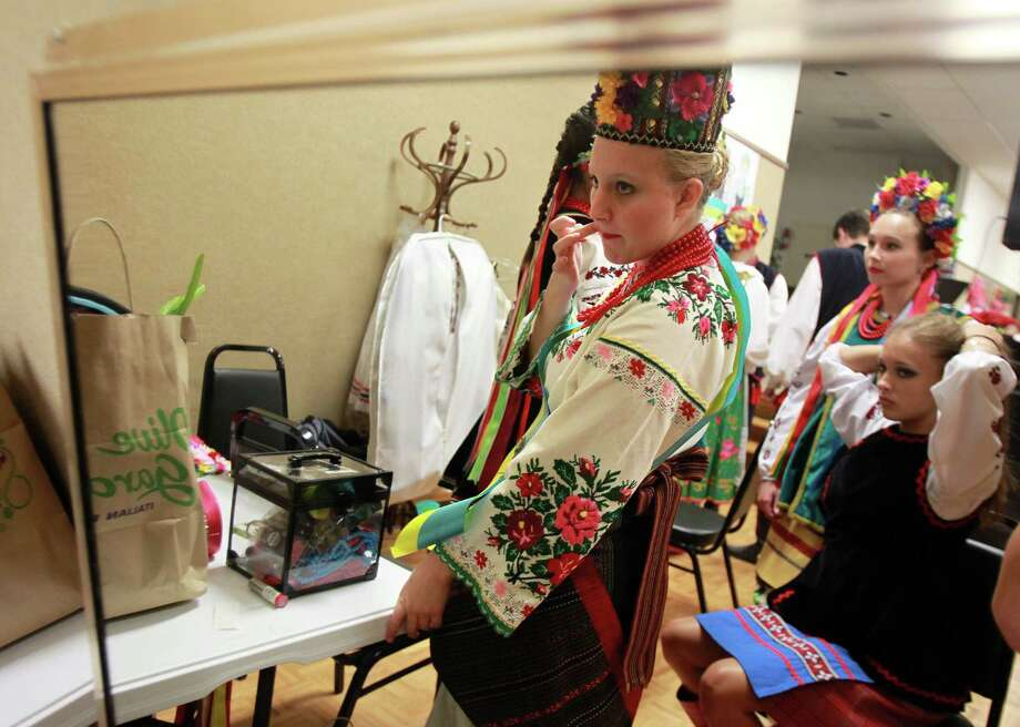 Gabrielle Spring, 16, applies lipstick before she is announced the Ukrainian Princess of the 50th Annual Sts. Gyril & Methodius Slavic Heritage Festival held at Knights of Columbus Hall and Grounds on Sunday, Sept. 29, 2013, in Houston. Photo: Mayra Beltran, Houston Chronicle / © 2013 Houston Chronicle