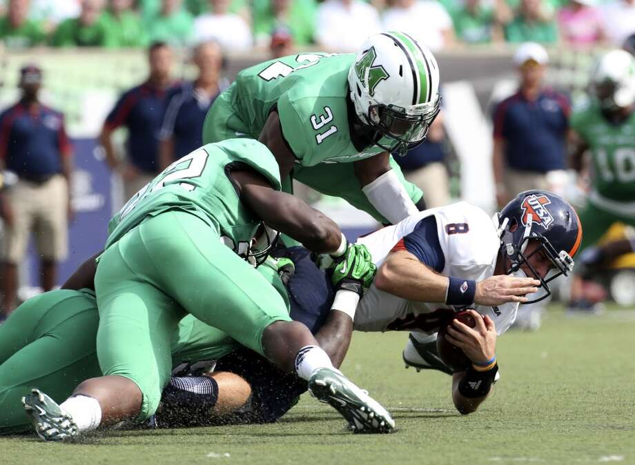 UTSA quarterback Eric Soza (8) is tackled by a host of Marshall defenders during an NCAA college football game at Joan C. Edwards Stadium, Saturday, Oct. 5, 2013, in Huntington, W.Va. Photo: Marcus Constantino, The Herald-Dispatch