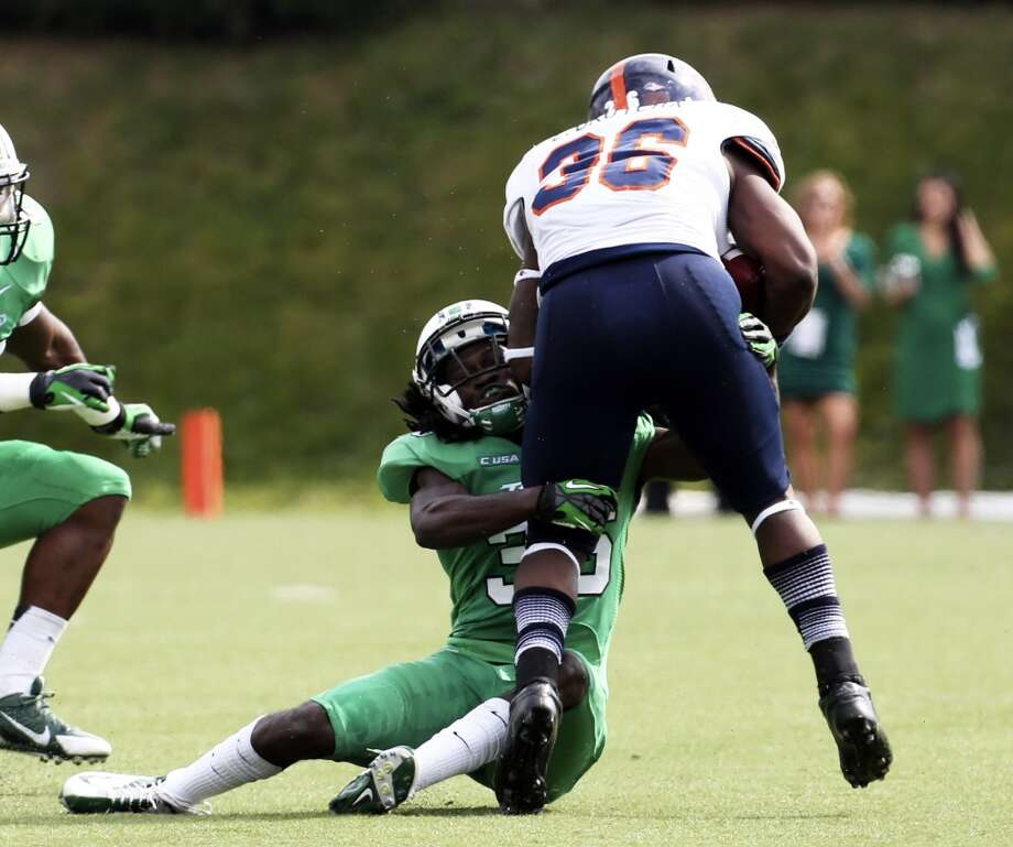 UTSA running back Evans Okotcha (36) is tackled by Marshall defensive back Monterius Lovett (36) during an NCAA college football game at Joan C. Edwards Stadium, Saturday, Oct. 5, 2013, in Huntington, W.Va. Photo: Marcus Constantino, The Herald-Dispatch