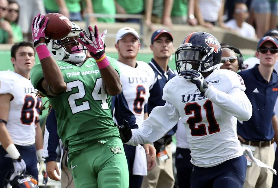 Marshall ide receiver Isaiah King catches a pass for 40-yards as UTSA cornerback Bennett Okotcha (21) defends during an NCAA college football game at Joan C. Edwards Stadium, Saturday, Oct. 5, 2013, in Huntington, W.Va. (AP Photo/The Herald-Dispatch, Marcus Constantino) Photo: Marcus Constantino, Associated Press