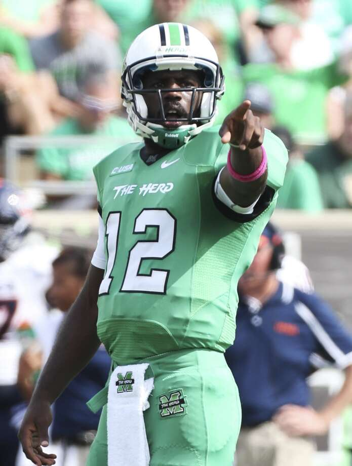 Marshall quarterback Rakeem Cato (12) calls the play against UTSA during an NCAA college football game at Joan C. Edwards Stadium, Saturday, Oct. 5, 2013, in Huntington, W.Va. Photo: Marcus Constantino, The Herald-Dispatch