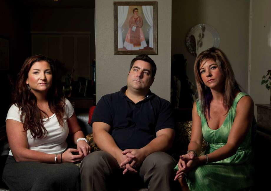 Elvia Baranowski's children - Angela, left, David and Isabell - regret not knowing more about the stranger she met online. Photo: Johnny Hanson, Staff / Houston Chronicle