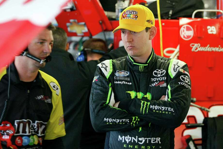 CORRECTS DATE, TO SATURDAY, OCT. 5, NOT FRIDAY, OCT. 4 - Kyle Busch looks on in the garage as his backup car is prepped for practice for Sunday's NASCAR Sprint Cup race at Kansas Speedway in Kansas City, Kan., Saturday, Oct. 5, 2013. Busch crashed his main car into the wall during his first run. (AP Photo/Colin E. Braley) ORG XMIT: KSCB103 Photo: Colin E. Braley / FR123678 AP