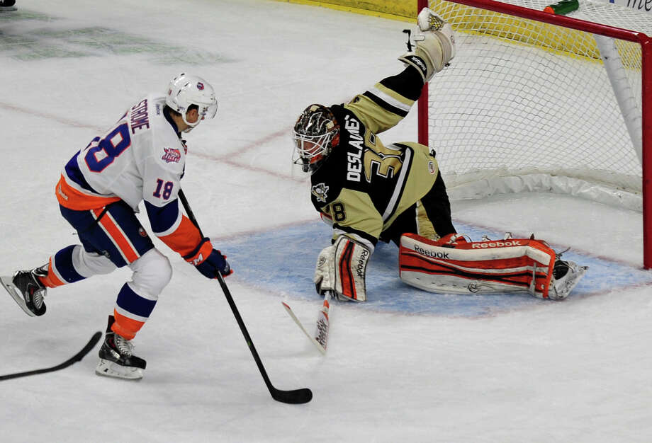 Sound Tigers Ryan Strome tries to line up a goal shot against Wilkes-Barre Scranton Penguins goalie Jeff Deslauriers, during opening night hockey action at the Webster Bank Arena in Bridgeport, Conn. on Saturday October 5, 2013. Strome missed in this attempt. Photo: Christian Abraham / Connecticut Post