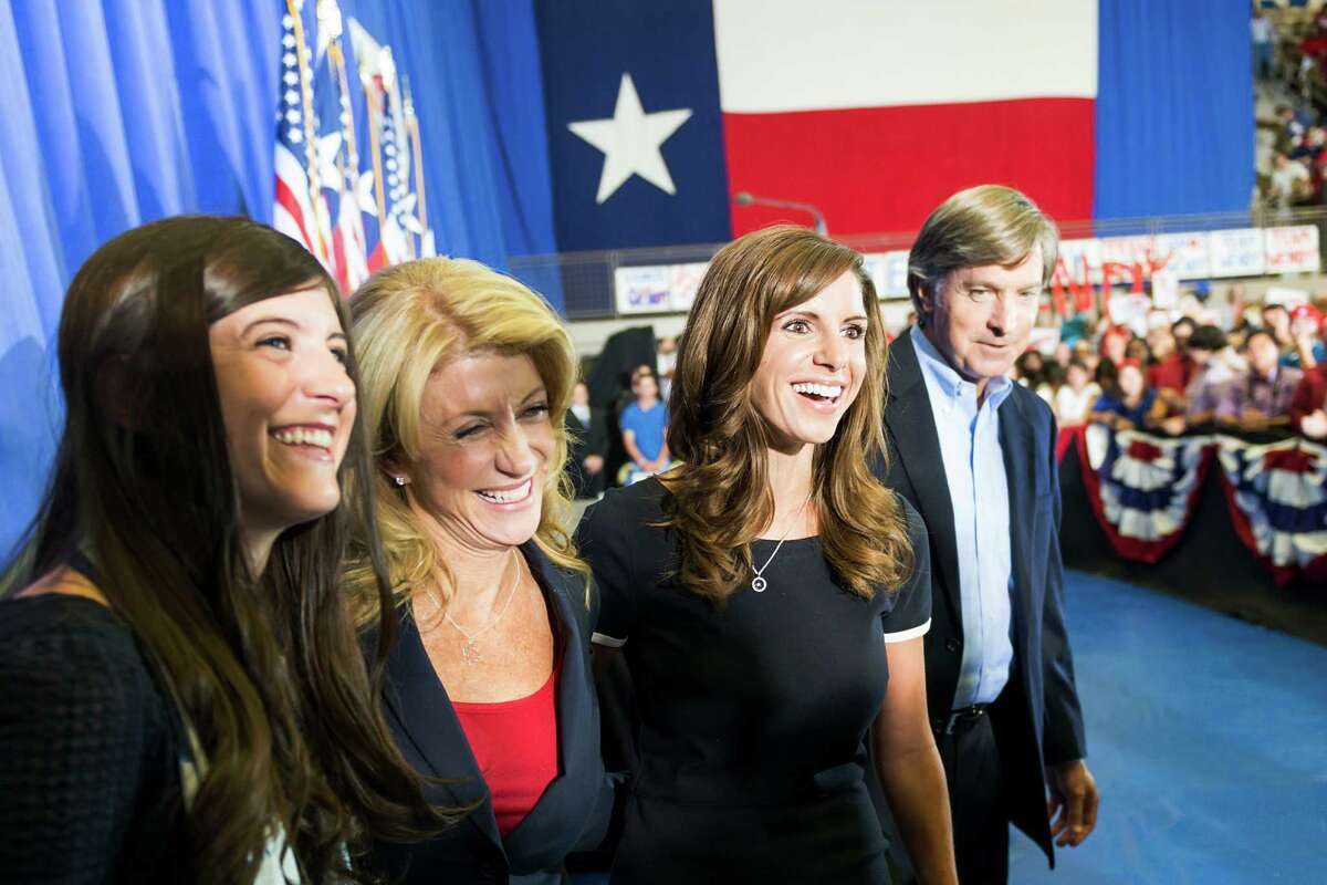 Wendy Davis, flanked by daughters Dru, left, and Amber, was joined by former Austin Mayor Will Wynn after the Fort Worth Democratic senator announced her candidacy for the Texas governor's race at Wiley G. Thomas Coliseum in Haltom City last week.