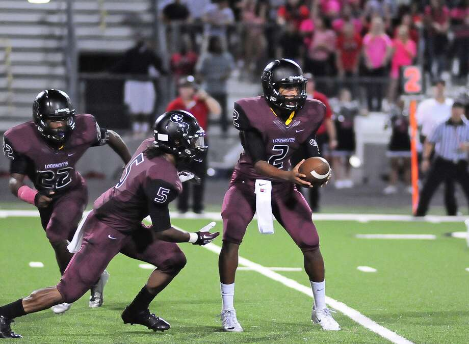 George Ranch quarterback Timon Nolan (cq) (#2) hands off to running back Xavian Marks (cq) (#5) with running back Collins Kwabena (cq) (#22) at left during the second half of their game with Terry at Traylor Stadium in Rosenberg. Photo: © Tony Bullard 2013, Tony Bullard / © Tony Bullard & the Houston Chronicle