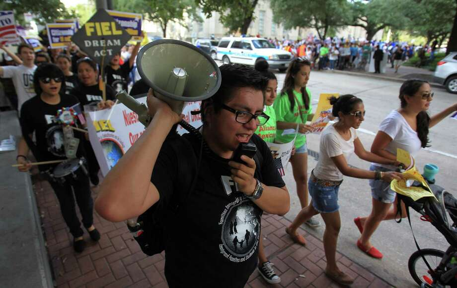 The rally on Saturday promoted immigration reform even as Congress faces distractions, organizers said. Photo: Karen Warren, Staff / © 2013 Houston Chronicle