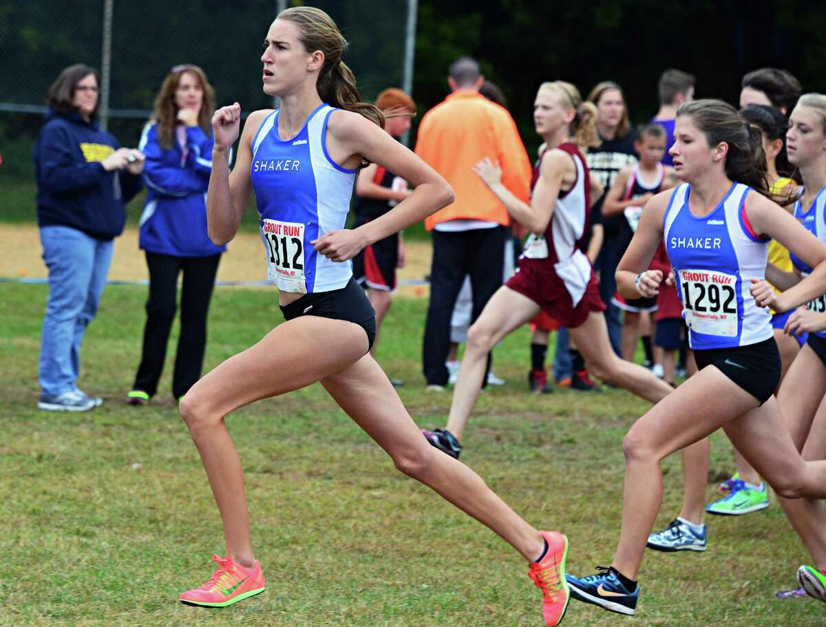 Shaker's Maryanna Lansing takes an early lead on her way to winning the Girls Class A race at the annual Grout Run cross country meet in Central Park Saturday Oct. 5, 2013, in Schenectady, NY. (John Carl D'Annibale / Times Union)
