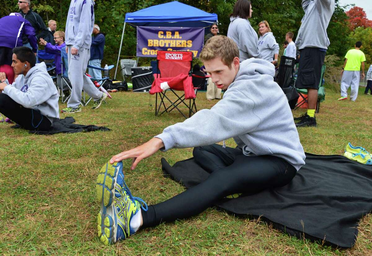 CBA's Justin Van Epps stretches before his run at the annual Grout Run cross country meet in Central Park Saturday Oct. 5, 2013, in Schenectady, NY. (John Carl D'Annibale / Times Union)