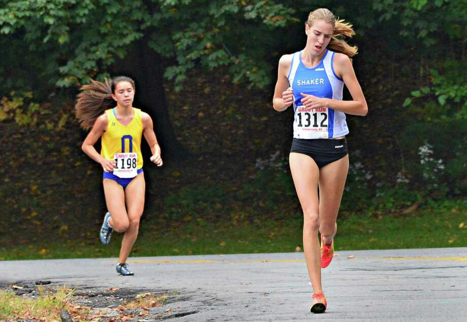 Shaker's Maryanna Lansing, at right, maintains her lead over Queensbury's Megan Kellogg during the Girls Class A race at the annual Grout Run cross country meet in Central Park Saturday Oct. 5, 2013, in Schenectady, NY.  (John Carl D'Annibale / Times Union) Photo: John Carl D'Annibale / 00024111A