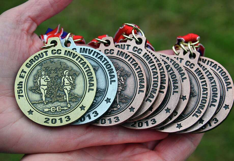 Medals at the annual Grout Run cross country meet in Central Park Saturday Oct. 5, 2013, in Schenectady, NY.  (John Carl D'Annibale / Times Union) Photo: John Carl D'Annibale / 00024111A