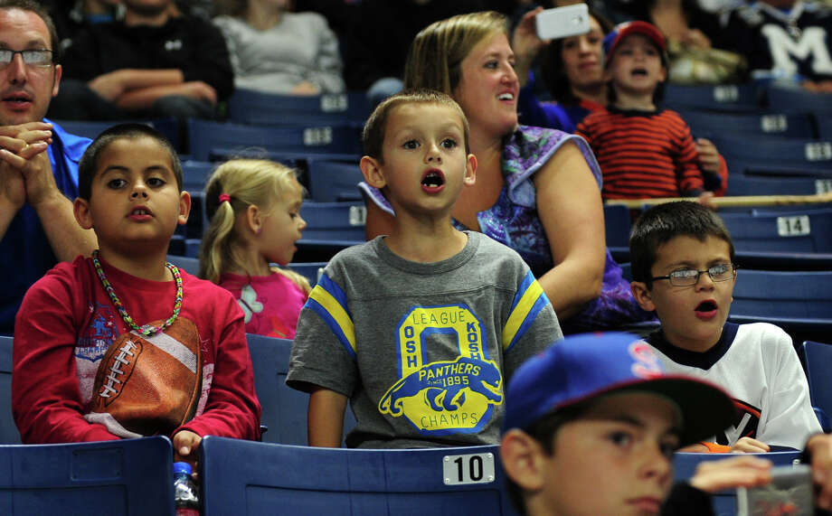 Gavin Gabriel, 7, of Monroe, in center, reacts during during opening night hockey action between the Bridgeport Sound Tigers and the Wilkes-Barre Scranton Penguins at the Webster Bank Arena in Bridgeport, Conn. on Saturday October 5, 2013. Photo: Christian Abraham / Connecticut Post