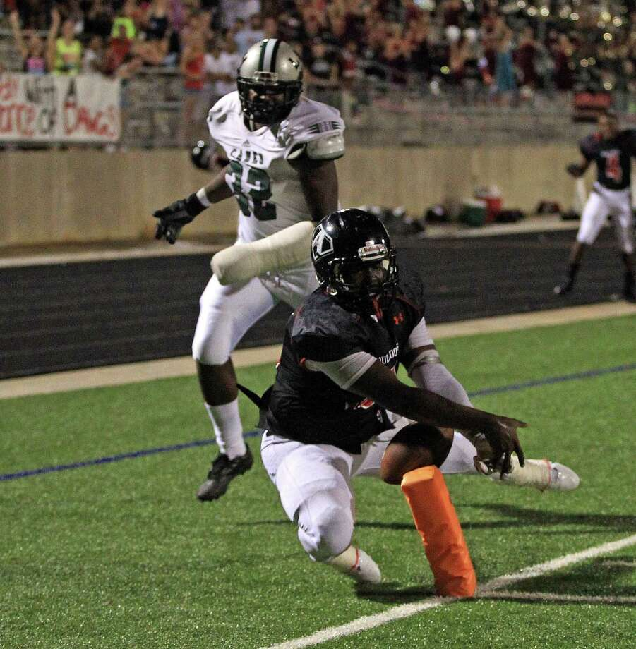 Austin's Seun Aboderin scores a 48-yard touchdown as Hightower's Daiquan Blount looks on during the second half of a high school football game, Saturday, October 5, 2013 at Hall Stadium in Missouri City. Photo: Eric Christian Smith, For The Chronicle