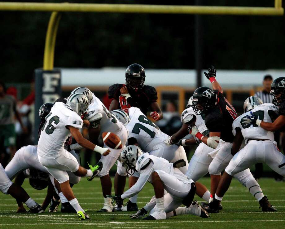 Hightower's Rene Fuentes kicks a 38-yard field goal as time expired in the first half during a high school football game against Austin, Saturday, October 5, 2013 at Hall Stadium in Missouri City. Photo: Eric Christian Smith, For The Chronicle