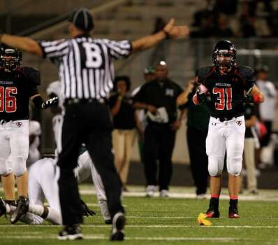 Austin's Logan Blanchfield (31) protests having a personal foul called on him during the second half of a high school football game against Hightower, Saturday, October 5, 2013 at Hall Stadium in Missouri City. Photo: Eric Christian Smith, For The Chronicle