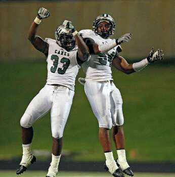 Hightower's Chibuzor Ugwu, right, celebrates his fumble recovery with Brandon White during the second half of a high school football game against Austin, Saturday, October 5, 2013 at Hall Stadium in Missouri City. Photo: Eric Christian Smith, For The Chronicle