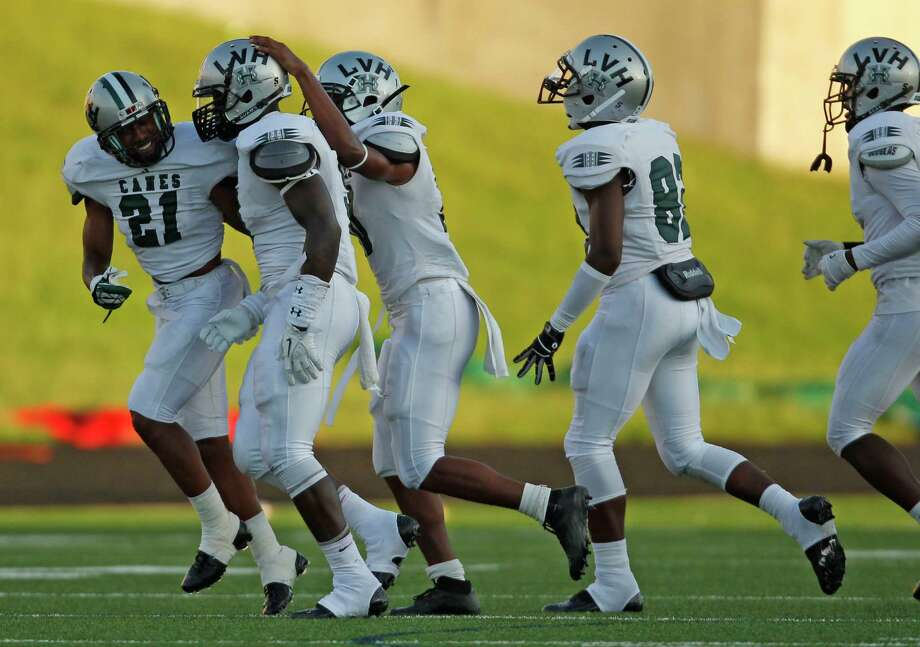 Hightower's Matthew Adams, second from left, celebrates his interception with teammates during the first half of a high school football game against Austin, Saturday, October 5, 2013 at Hall Stadium in Missouri City. Photo: Eric Christian Smith, For The Chronicle
