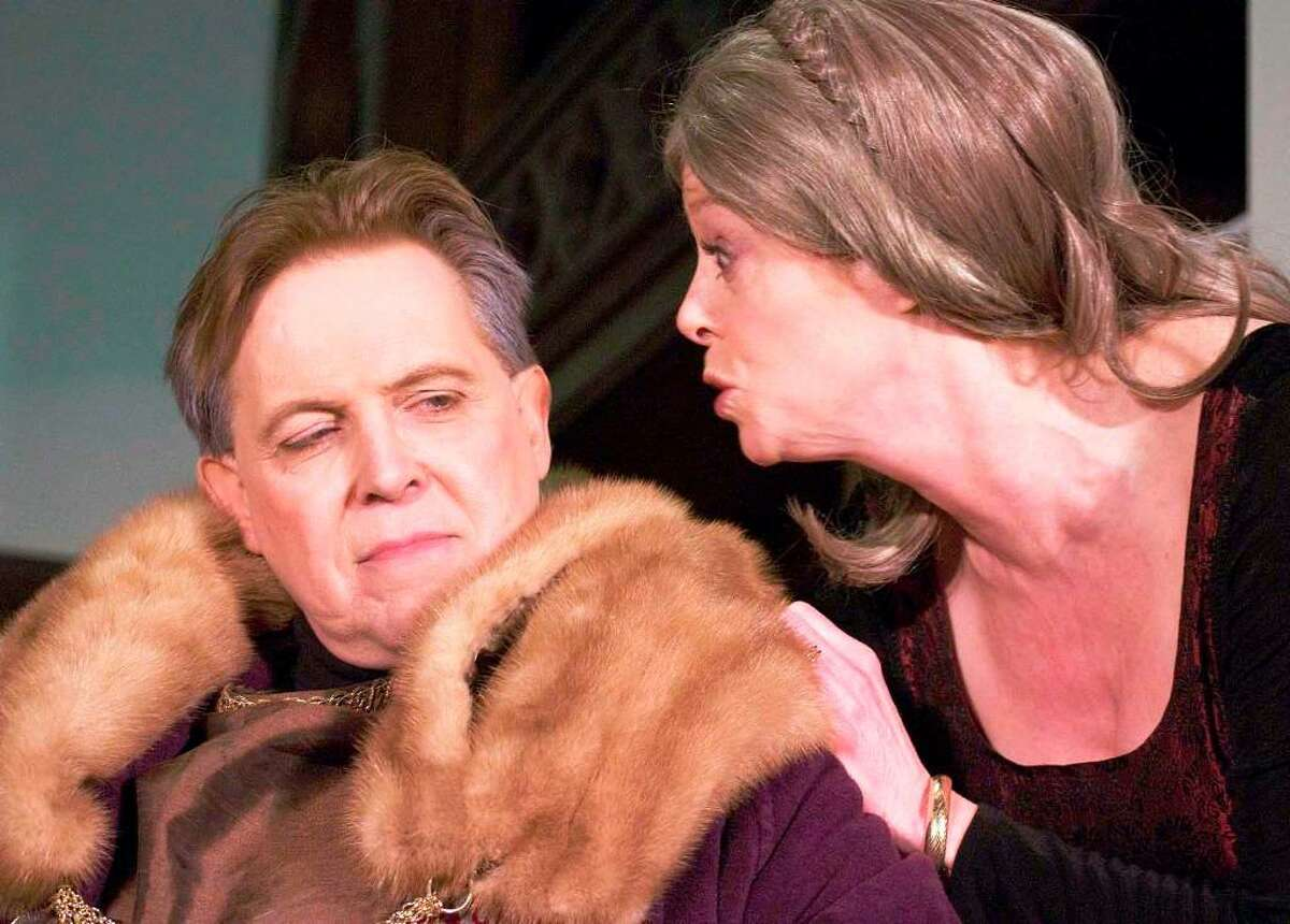Jody Bayer of Danbury and Bruce Tredwell of Brewster spar as Queen Eleanor and King Henry in