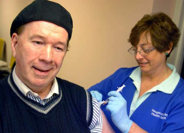 Jack Donovan, of Shelton, gets the H1N1 vaccine Tuesday Jan. 26, 2010 at the Derby Senior Center.  The Naugatuck Valley Health District is holding free weekly vaccination clinics, for more information visit www.nvhd.org. Photo: Autumn Driscoll / Connecticut Post