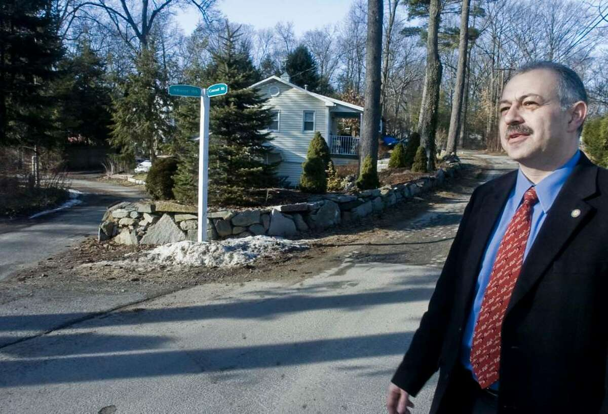 City engineer Farid Khouri stands at the corner of Albert and Cornell Roads. Well traveled narrow roads with rock ledge close to the roadsides would make and construction disruption very difficult for the residents. Thursday, Jan. 21, 2010