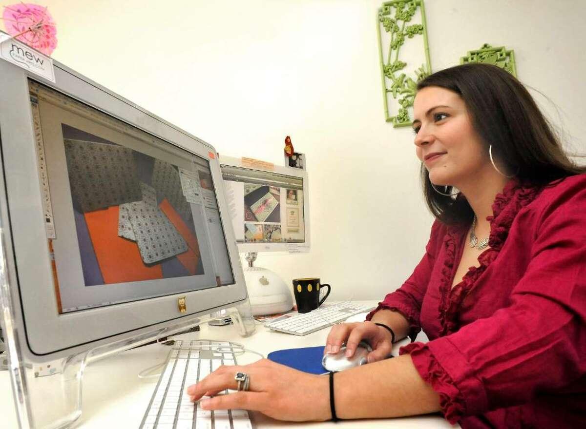 Alissa Harvey works on new stationery design in her Danbury studio, on Thursday, Jan.14,2010.