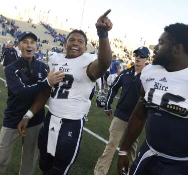 Rice's Darik Dillard, center, celebrates after he made the game winning touchdown during an overtime NCAA college football game against Tulsa, Oct. 5, 2013, at Chapman Stadium in Tulsa, Okla. (AP Photo/Tulsa World, Tom Gilbert) Photo: Tom Gilbert, Associated Press
