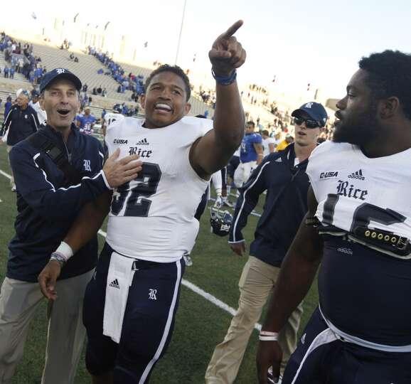 Rice's Darik Dillard, center, celebrates after he made the game winning touchdown during an overtime