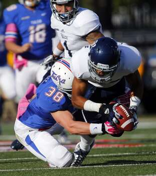 Rice's Bryce Callahan, right, fumbles a punt return as Tulsa's Matt Linscott pressures during the second half an NCAA college football game Oct. 5, 2013, at Chapman Stadium in Tulsa, Okla. (AP Photo/Tulsa World, Tom Gilbert) Photo: Tom Gilbert, Associated Press