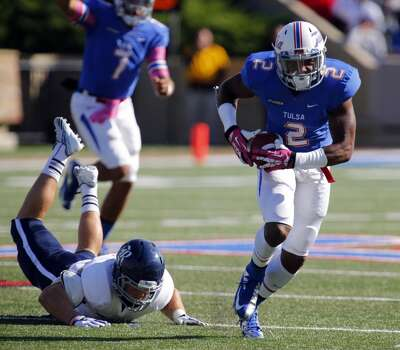Tulsa's Keevan Lucas, right, runs away from Rice during an NCAA college football game Oct. 5, 2013, at Chapman Stadium in Tulsa, Okla. (AP Photo/Tulsa World, Tom Gilbert) Photo: Tom Gilbert, Associated Press