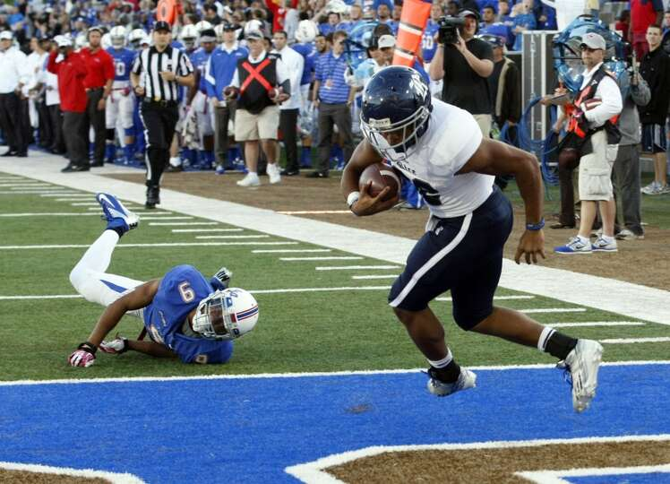 Rice's Darik Dillard, right, runs toward the end zone for the game winning touchdown during overtime