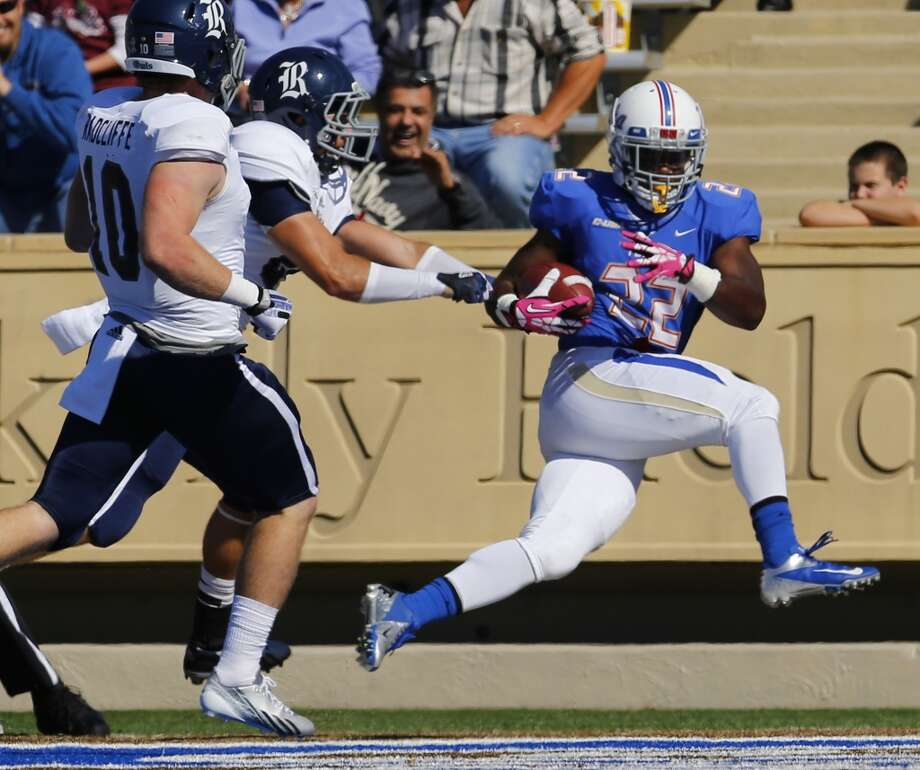 Tulsa's Trey Watts, right, gets into the end zone during the first half of an NCAA college football game against Rice Oct. 5, 2013, at Chapman Stadium in Tulsa, Okla. (AP Photo/Tulsa World, Tom Gilbert) Photo: Tom Gilbert, Associated Press