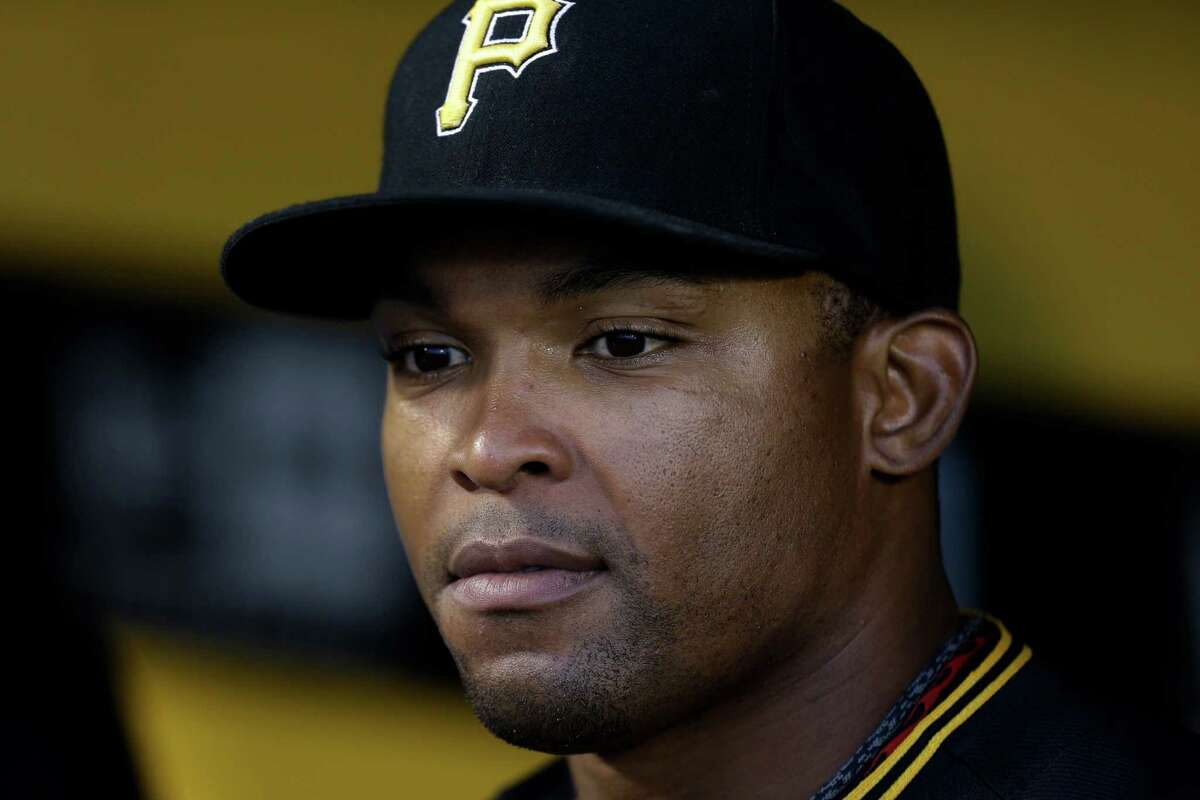 Pittsburgh Pirates' Marlon Byrd stands in the dugout before a baseball game against the Chicago Cubs in Pittsburgh Thursday, Sept. 12, 2013. The Pirates won 3-1. (AP Photo/Gene J. Puskar)
