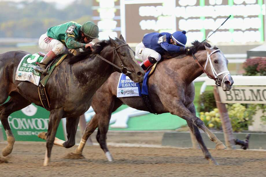 In a photo provided by the New York Racing Association, Havana, right, with Irad Ortiz Jr. aboard, captures the Foxwoods Champagne Stakes horse race at Belmont Park in New York, Saturday, Oct. 5, 2013. Honor Code, left, with Javier Castellano aboard, placed second. (AP Photo/New York Racing Association) ORG XMIT: XNYA104 / New York Racing Association