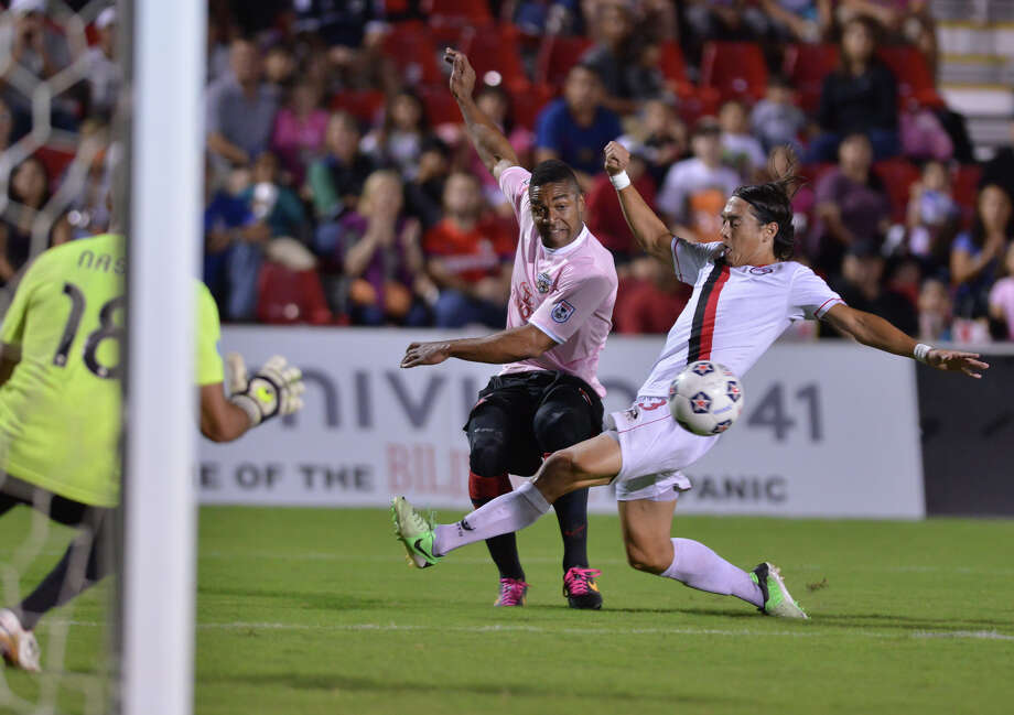 Scorpions Lyle Martin fires a shot on goal past Atlanta's Brandon Mazonelli during first half action Saturday night at Toyota Field Photo: Robin Jerstad