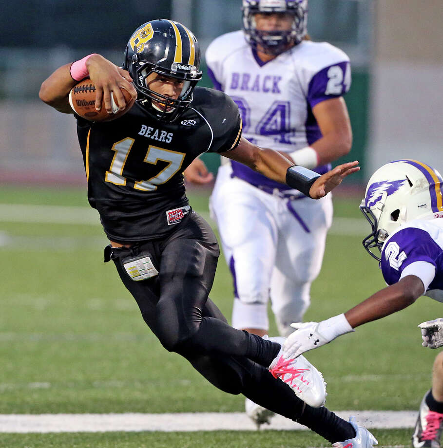 Bear quarterback Da'shawn key makes a cut away on the right and heads for a touchdown to start the scoring as Brennan hosts Brackenridge at Farris Stadium on October 5, 2013. Photo: TOM REEL
