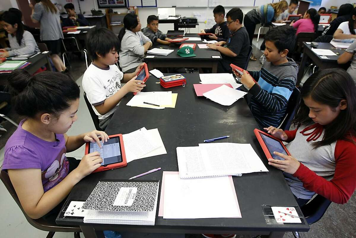 Students use iPads for a poetry project during Mrs. Gorsky's 7th grade science class at Martin Luther King Jr. Middle School in San Francisco, California Friday October 4, 2013. San Francisco Mayor Ed Lee is scheduled on Monday to announce a school program including a large donation of new iPads to the Martin Luther King Jr. Middle School in San Francisco's Portola District
