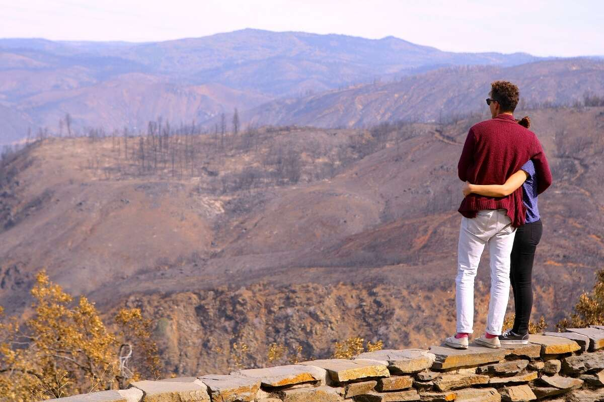 John Fauls and Sally Anderson, on vacation from Australia, said they were touched by view from Rim of the World Vista -- everything in their view burned in Rim Fire