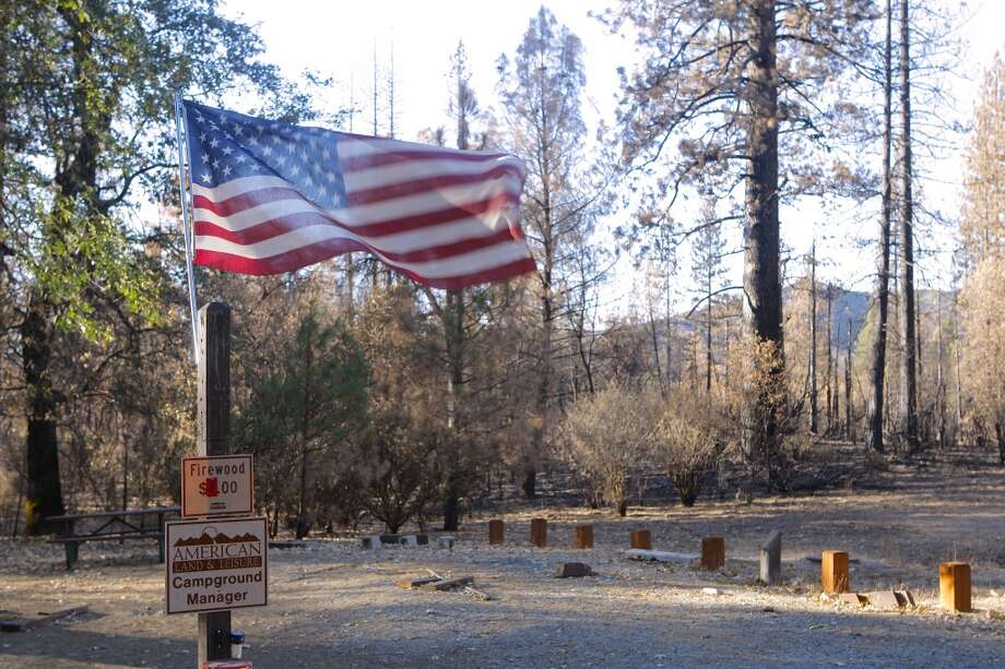 Never say die: At Sweetwater Camp, a Forest Service site along Highway 120, a camp host posted a flag at his abandoned campsite Photo: Tom Stienstra/The Chronicle