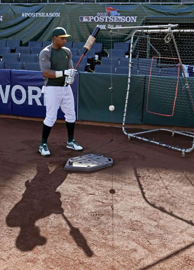 A's Yoenis Cespedes, (52) takes practice before the start of the game,on Saturday Oct. 5, 2013, in Oakland, Calif. at O.co Coliseum, as the Oakland Athletics prepare to take on the Detroit Tigers in game two of the MLB American League Division Series. Photo: Michael Macor, The Chronicle