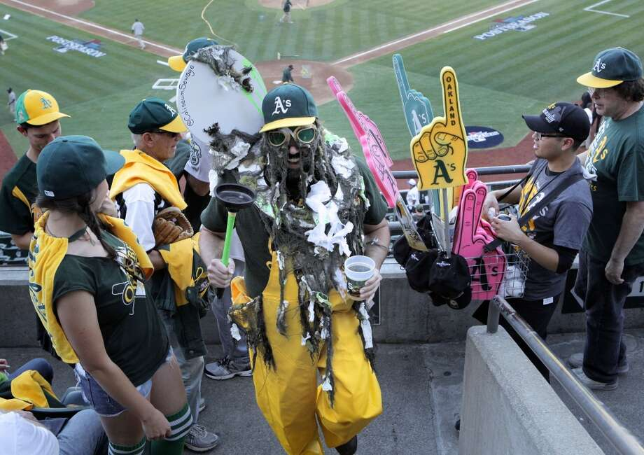 "A's fan known as ""Coliseum Sewage"" makes the rounds through the stands before the start, on Saturday Oct. 5, 2013, in Oakland, Calif. at O.co Coliseum, as the Oakland Athletics prepare take on the Detroit Tigers in game two of the MLB American League Division Series. Photo: Michael Macor, The Chronicle"