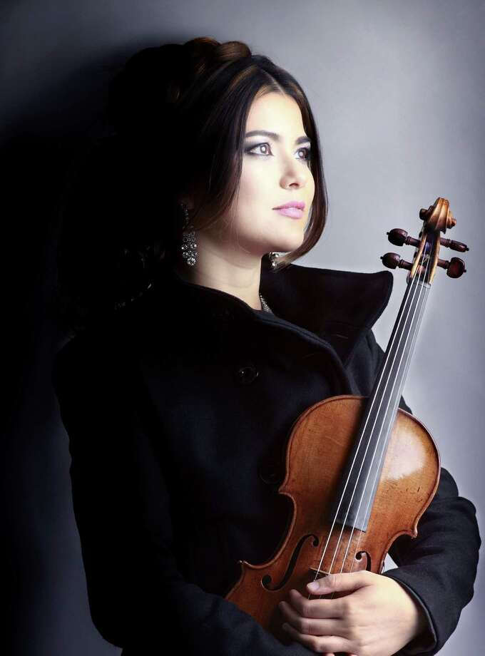 The sound guest violinist Karen Gomyo summoned from her 310-year-old Stradivarius was worth the admission alone.