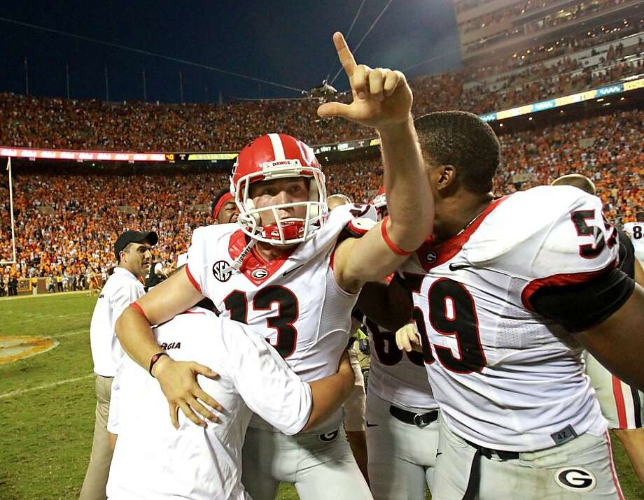 Georgia kicker Marshall Morgan celebrates after his 42-yard field goal in overtime against Tennessee. Photo: Jason Getz, McClatchy-Tribune News Service